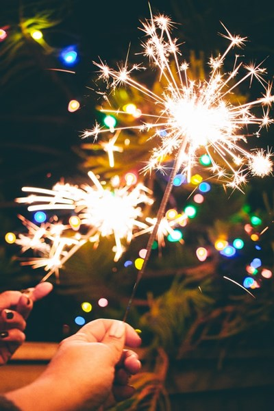 New_Years_Sparklers_with_Christmas_Lights_in_the_background